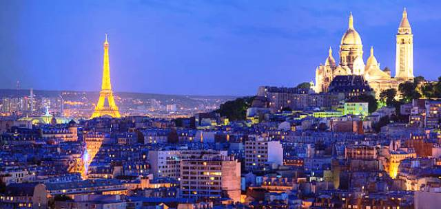 Panoramic view of the Sacre Coeur basilica, Montmartre and illuminated Eiffel Tower at night