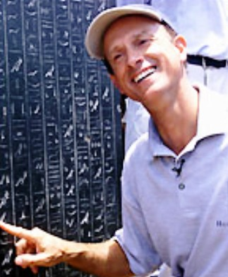 The head of the French underwater archaeologists work in Heracleion, Franck Goddio, poses Thursday June 7, 2001 with an intact stele covered with hieroglyphic inscriptions, dating from Nectanebo I.  More than 1,000 years ago, an earthquake sent the Pharaonic city of Heracleion to the bottom of the Mediterranean.   (AP PHOTO/Amr Nabil)