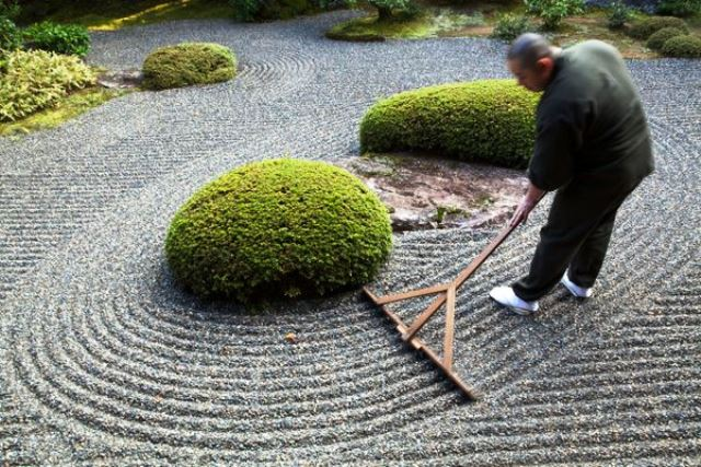 Rev Takafumi Kawakami is the vice-abbot at Shunkoin Temple and teaches classes about Zen culture and meditation and serves as a bridge between the Eastern and Western cultures. Here Rev Takafumi is raking the temple's Zen Garden. The Garden of Bolders, or Sazareishi-no-niwa, is the main garden of Shunkoin. The theme of the garden is the Great Shrine of Ise in Mie Prefecture. The Great Shrine of Ise is the head shrine of all Shinto shrines in Japan. This garden houses a shrine to Toyouke-no-omikami, a goddess of agriculture.
