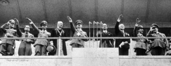 07 Aug 1936, Berlin, Germany --- Here is the scene in the Olympic Stadium, Berlin, as Chancellor Adolf Hitler declared the Olympiad officially open.  Left to right on the platform are, War Minister Von Blomberg; Rudolph Hess, Member of the Cabinet; third man unidentified; Dr. Von Lewald, president of Olympic Organizing Committee; Chancellor Hitler; Crown Prince Humbert of Italy; M. La, our head of the Olympic Committee German Propaganda Minister Goebbels; General Herman Goering and (under movie camera) Fraulein Leni Riefenstahl, who is directing the making of a photographic record of the Olympiad. --- Image by © Bettmann/CORBIS