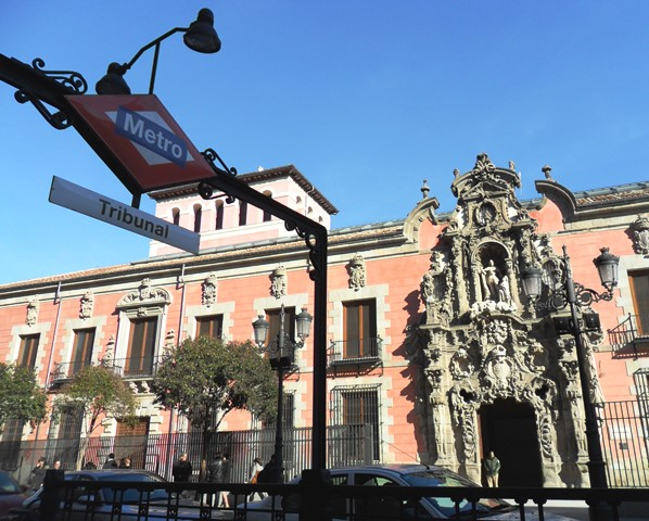 Entrance to 'TRIBUNAL' subway station in Centro district in Madrid (Spain). Background: History Museum (building from 1760).