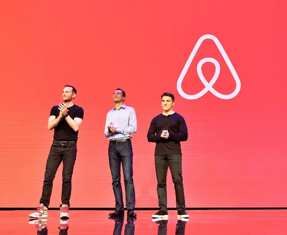 "LOS ANGELES, CA - NOVEMBER 17:  (L-R) Airbnb Founders Chief Product Officer Joe Gebbia, CTO Nathan Blecharczyk and CEO Brian Chesky speak onstage during the ""Introducing Trips"" Reveal at Airbnb Open LA on November 17, 2016 in Los Angeles, California.  (Photo by Stefanie Keenan/Getty Images for Airbnb)"