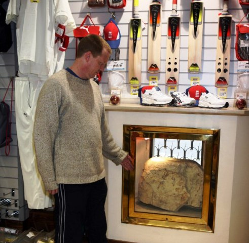ic by Graham Hussey pic shows the lLONDON STONE which is in canon street london .pic taken inside thetech sports shop with the manager CHRIS CHEEK.