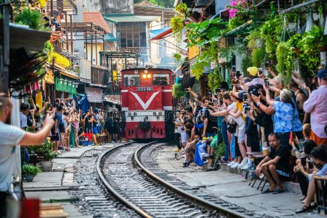 hanoi-vietnam-oct-view-train-passing-narrow-street-hanoi-old-quarter-tourists-taking-pictures-hurtling-161289767