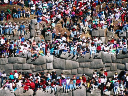 i-anson-richard-spectators-sitting-on-inca-walls-watching-inti-raymi-festival-sacsayhuaman-cuzco-peru